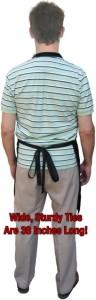 model wearing apron from rear showing long ties